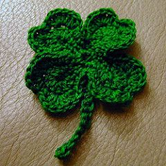 After trying several free patterns for a crocheted shamrock or four-leaf clover, I decided I didn't like any of them and improvised my own. I ended up liking my final product enough that I decided to write it down and share with everyone.