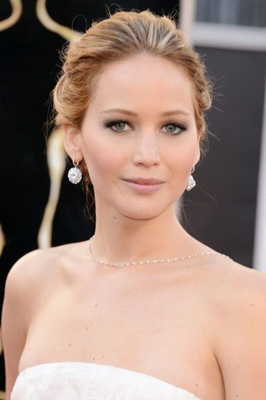 Jennifer Lawrence  The new face of Miss Dior Eau de Parfum took sophistication to a whole new level with a simple updo and heavily smoked eyes.