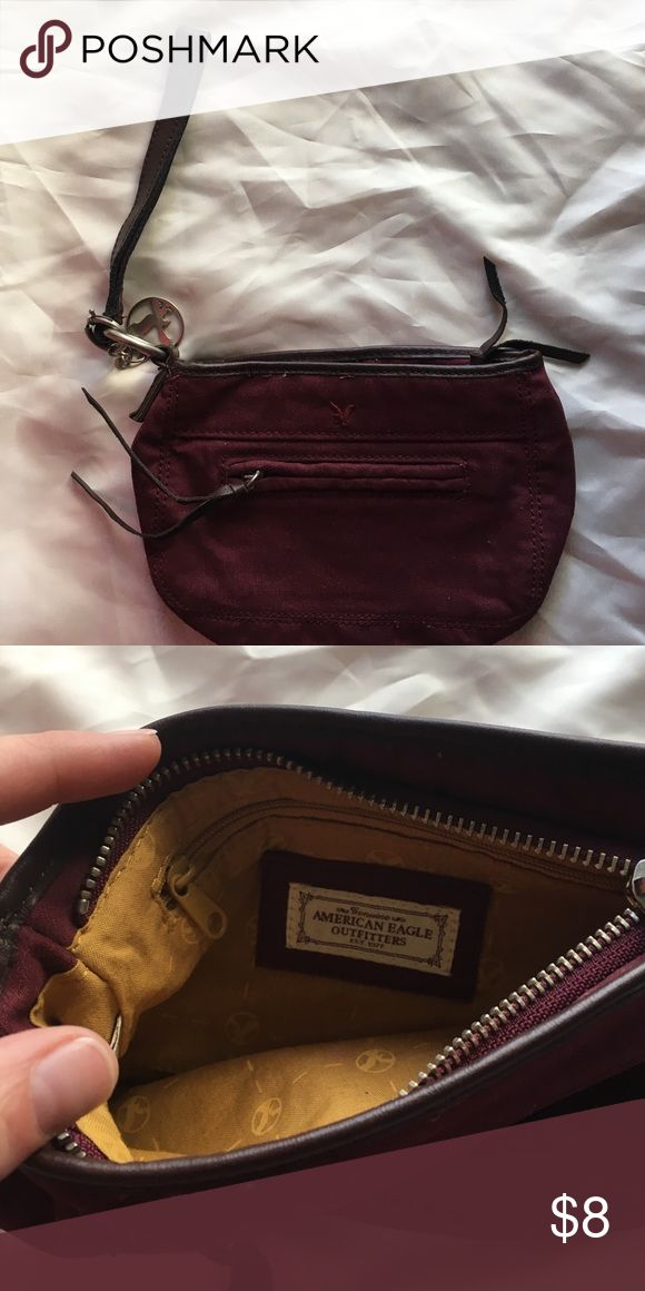 Maroon canvas wristlet Very cute maroon canvas with faux leather detailing. Used only a couple of times, looks brand new. Smoke free! American Eagle Outfitters Bags Clutches & Wristlets
