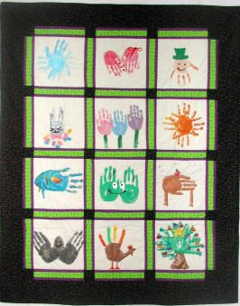I think this is such a lovely idea - a patchwork made using handprints.  Each block represents a month and has a theme to depict that month