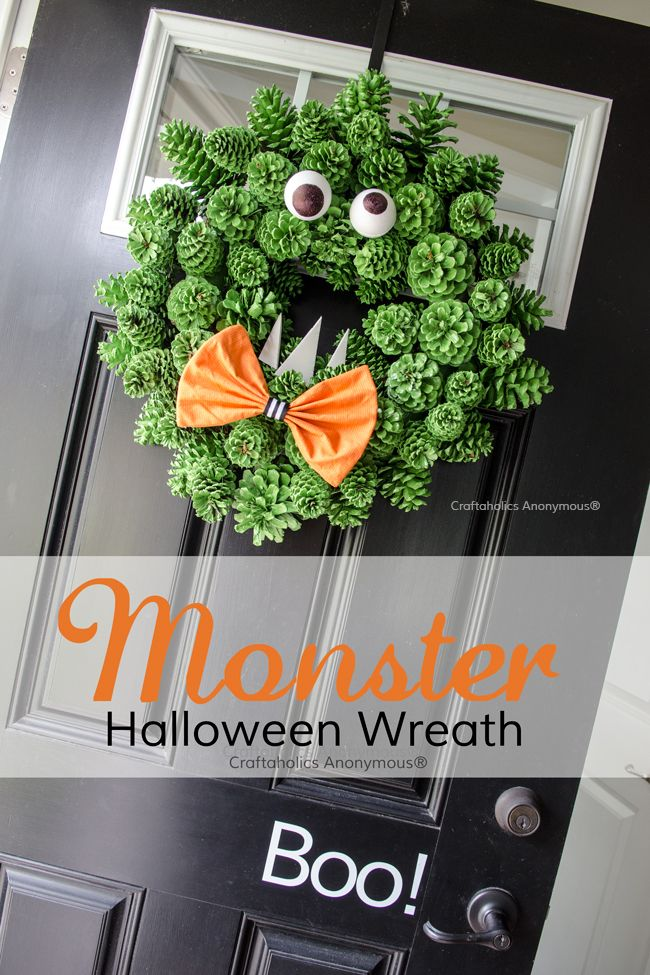 Love this Halloween monster wreath made with pinecones, fun color and texture!