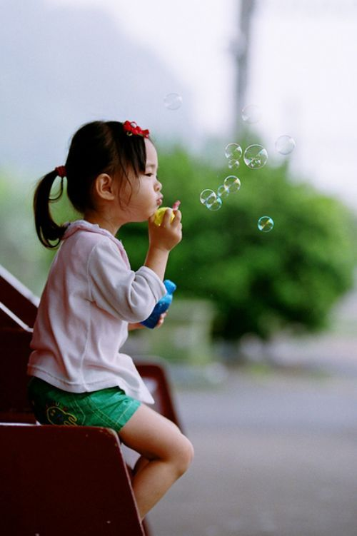 Remember: you were the sweet little girl that loved to sit on a swing and sing. And you thought that blowing bubbles was an art form.