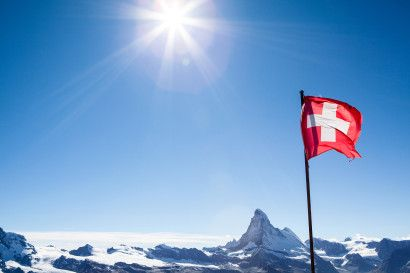 Swiss flag with Matterhorn (Cervino, Hörnli), Zermatt, Swiss alps, Switzerland
