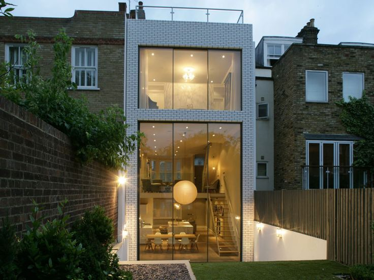 Classic London architecture from the front, modern surprise from the back. Light and open urban living.