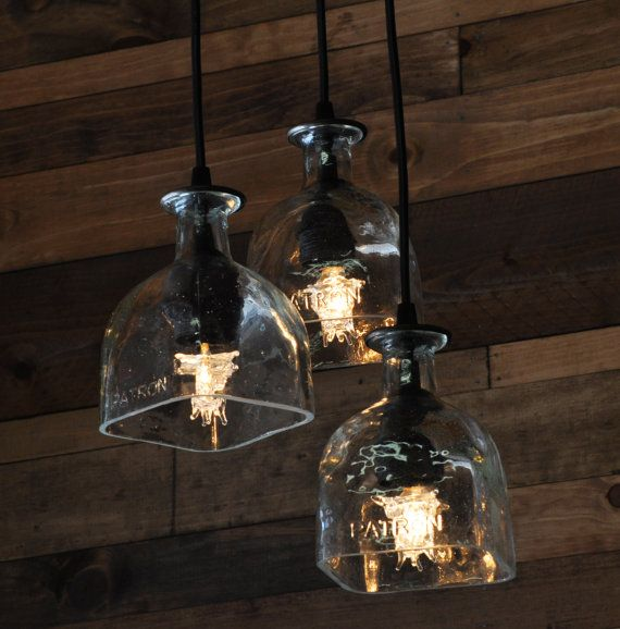 The Patron 3-Light Chandelier.  Groovy dripping lightbulbs add to the icy hot feel of this great recycled bottle light.