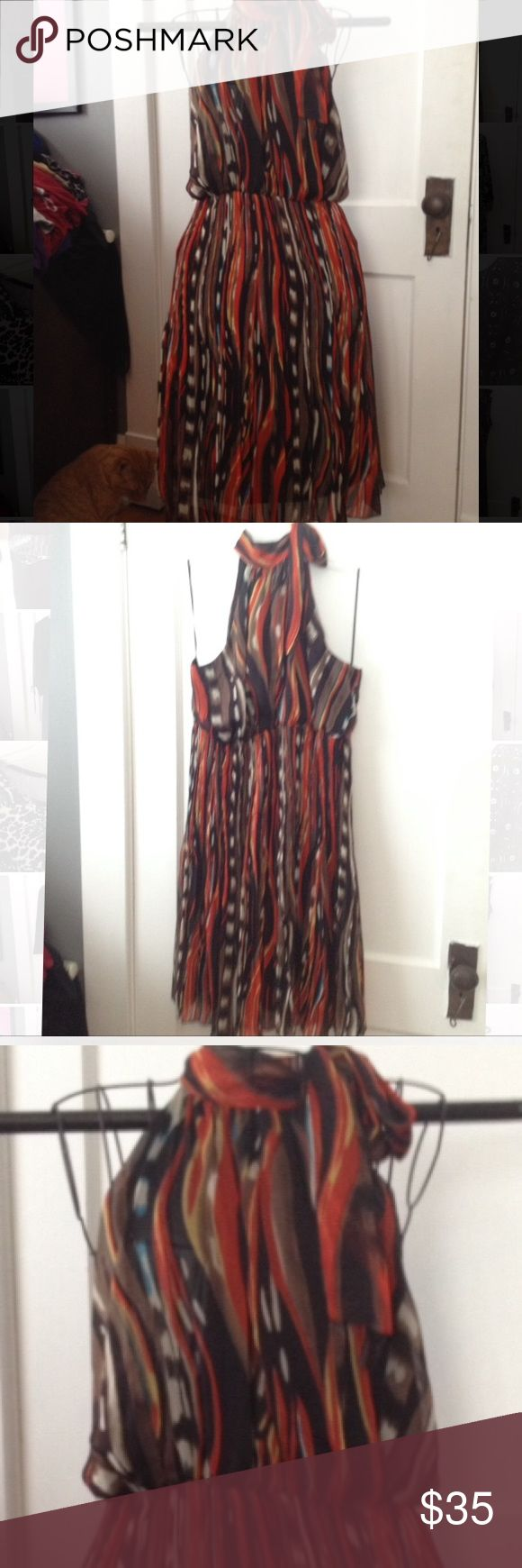 """Beautiful Ashley Stewart flowy dress. Gorgeous Ashley Stewart printed dress. Size 16. Hard to take a pic that did it justice. Tie at neck. Sleeveless. Lining. Length: 41"""" from shoulder; 32"""" from armpit. Hardly worn. Ashley Stewart Dresses"""