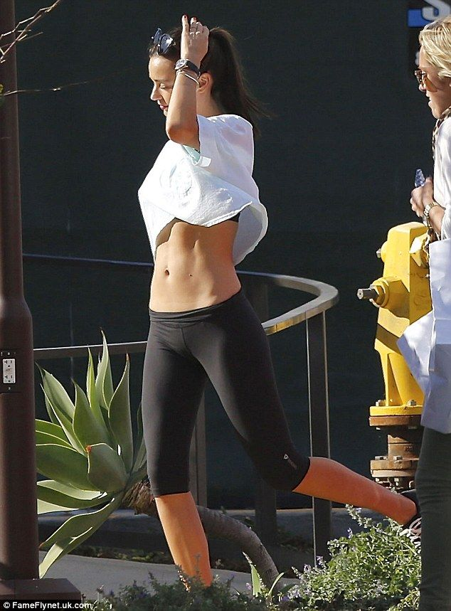 She's one athletic angel! Miranda Kerr shows off her incredibly toned stomach in a crop top as she leaves the gym in Malibu on Tuesday