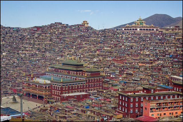 Larung Gar Buddhist Academy in Serthar, Tibet, also known as Serthar Buddhist Institute, sits in the Larung Valley at an elevation of 4,000 meters, about 15 km from the town Sêrtar, in Sertar County, Garze Prefecture in the traditional Tibetan region of Kham. The academy was founded in 1980 in an entirely uninhabited valley by Jigme Phuntsok, an influential lama of the Nyingma tradition.
