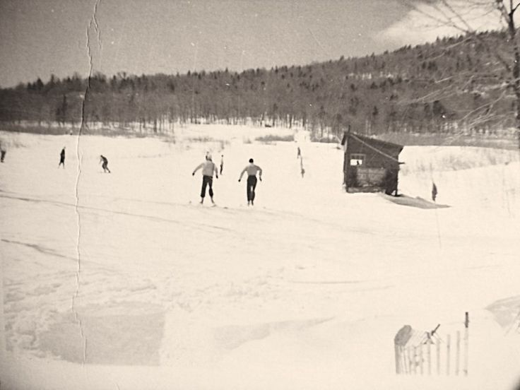 """A 1945 view of the North Slope rope tow area; the sign on the building says """"Sepp Ruschp Ski School."""" Stowe, VT"""