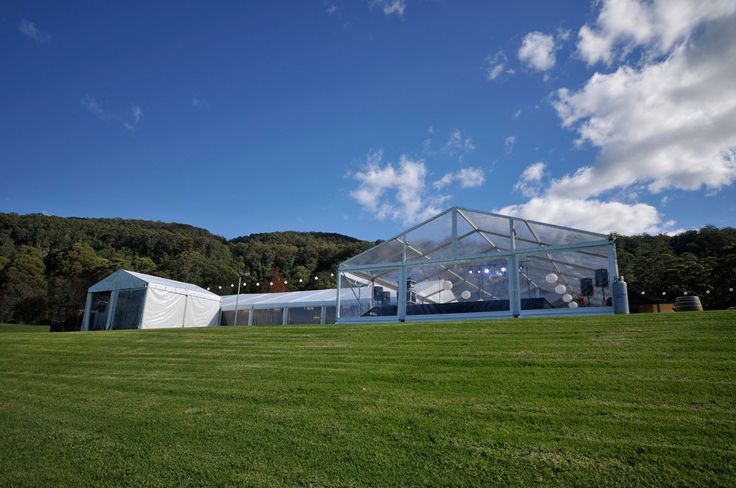 WEDDING MARQUEE. This wedding marquee in Kangaroo Valley featured a silk lined dining marquee, clear dancehall marquee and structures for catering and guest amenities. #weddings #YourEventSolution