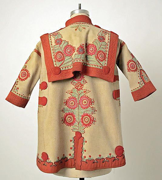 Hungarian Szur -- the cuffs are quilted -- which must have added longevity to them;   The border is beautiful as is the handwork on the back (tree of life like motif) and the beautiful cape