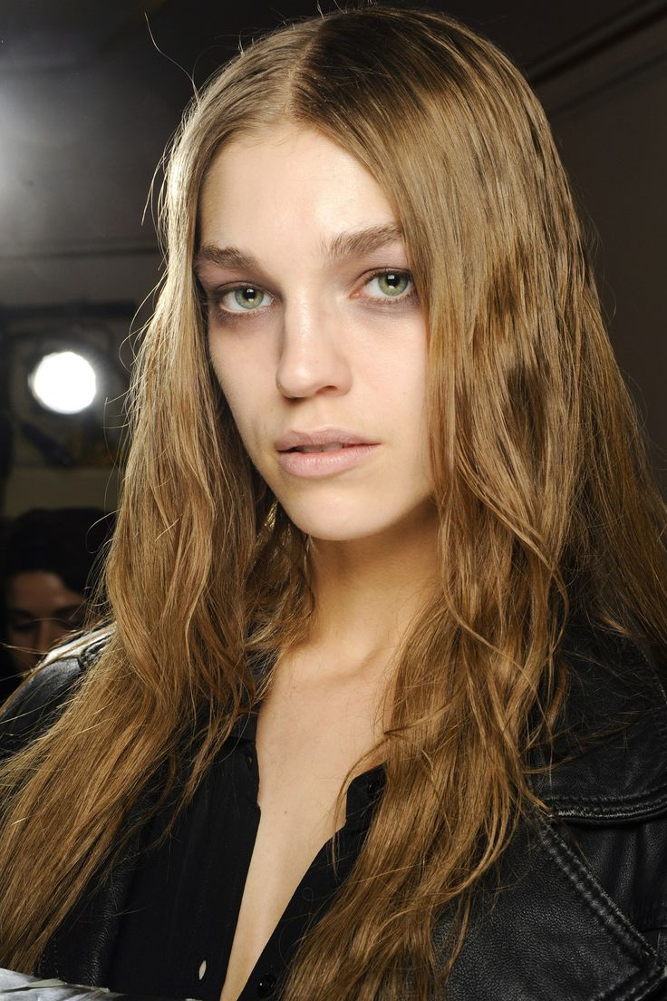 Backstage Hair: Autumn/Winter 2013-14 - Giles: Hair was parted at the centre, then fell in wet-look kinks, flat to the head.