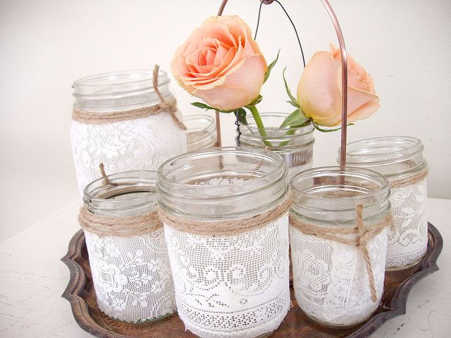 DIY - lace jar vases. Buy jar, wrap in lace and add twine. So cute and so fast and easy.