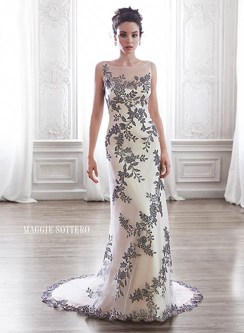 Tulle slim A-line wedding dress with bold floral appliques tracing the bodice, complete with illusion neckline and plunging V back, Vanja by Maggie Sottero.