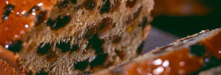 A sliced loaf of bara brith. Recipe for Bara Brith:450G/1lb self raising flour 1tsp mixed spice 175g/6oz Muscavado sugar 1 medium size free-range egg 1tbsp orange zest 2tbsp orange juice 1tbsp honey 300ml/½pt cold tea 450g/1lb mixed, dried fruit Extra honey for glazing