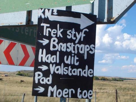 SA Road sign: Tighten the brastraps...remove false teeth...road to hell & gone!