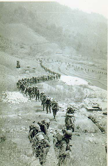 Marines on the move, may be at Punchbowl 1951