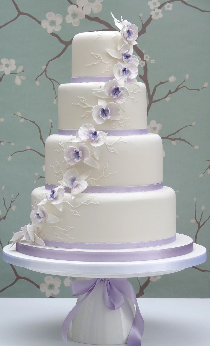Wedding Cake Lilac Orchid Cake by Planet Cake. A nice change from all the cherry blossoms out there!