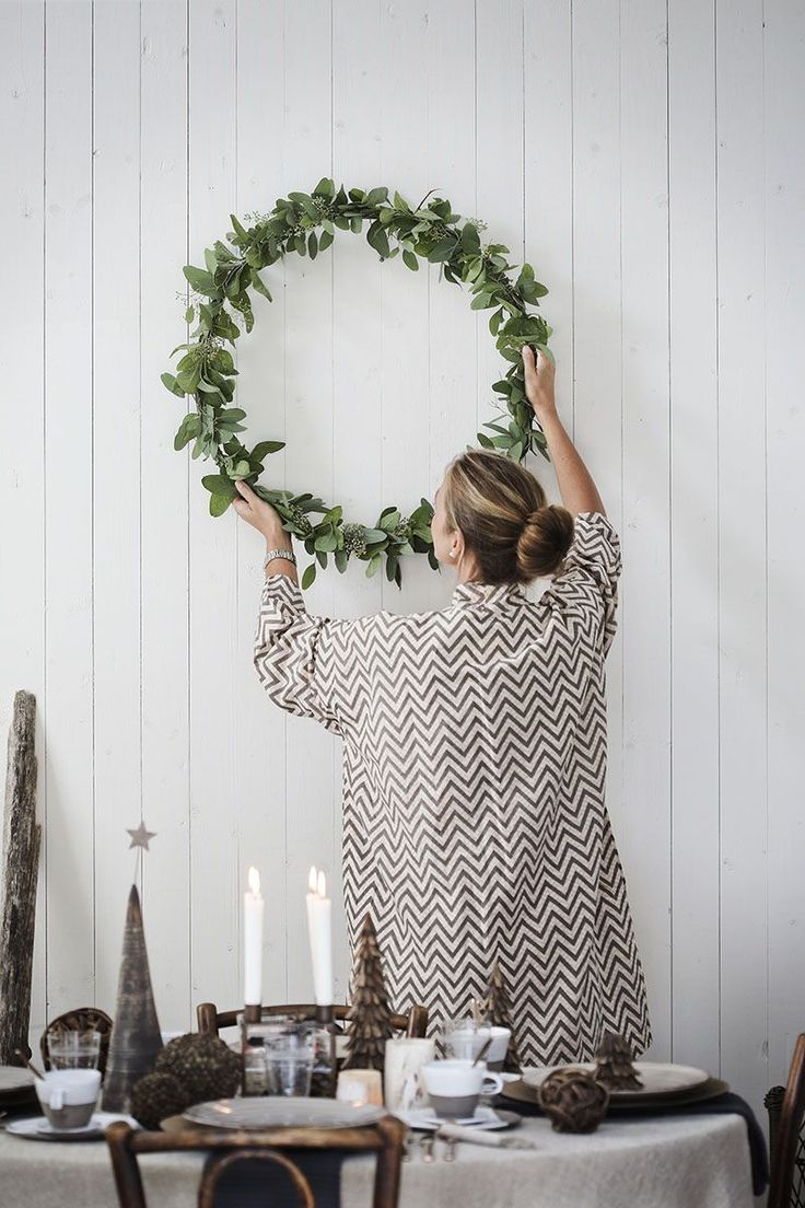 Modern organic Christmas decor. Use a giant hoop and keep the greenery slender - with initial in the center