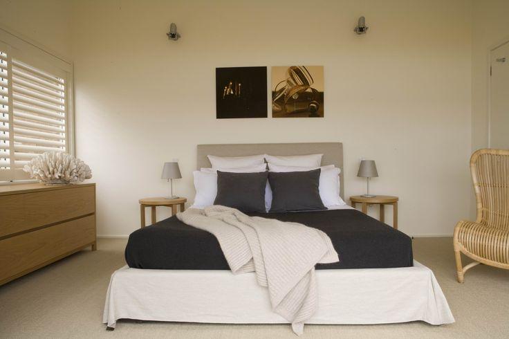 Second bedroom with artwork by Pauline Plumb. Brooke Aitken Design.