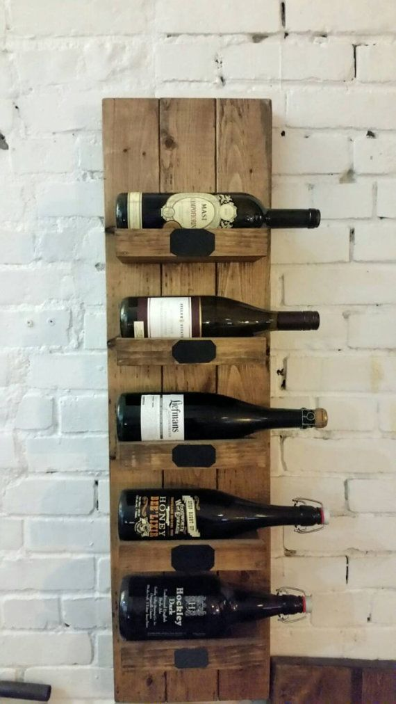 This beautiful handmade wine rack will add a warm but rustic feel to any room This piece is finished with a walnut stain and hand distressed to give it the perfect rustic look. It measures 39 high and 10.5 wide and fits 5 standard wine bottles. Use the chalk labels on the shelf to personalize each bottle!  Also available in a smaller, 3 shelf and 4 shelf option!  Dont drink wine? It fits beer bottles! Please contact for more questions.  Custom sizes are available.  Pickup available in…