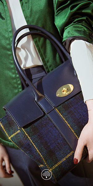 """Discover the New Bayswater in Navy Tartan Wool, worn by Grace Chang Tellier, Managing Director of Meri Media. """"My typical day is definitely full! It might involve a team meeting, lunch and phonically with clients in various timezones, meeting a photographer, then catching a plane to Milan. The Bayswater is roomy – I can fit in all my laptops and papers, but elegant enough to bring from office to dinner. I love the beautiful, unexpected materials in this collection."""""""