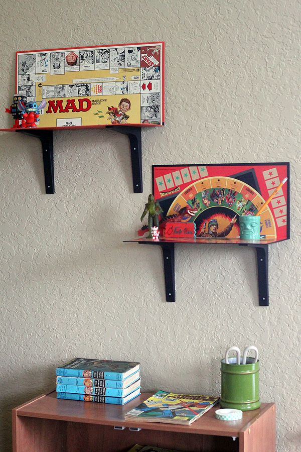 Fun for a playroom - turn old boardgames into shelves! If you don't have any lying around, search garage sales for good deals!