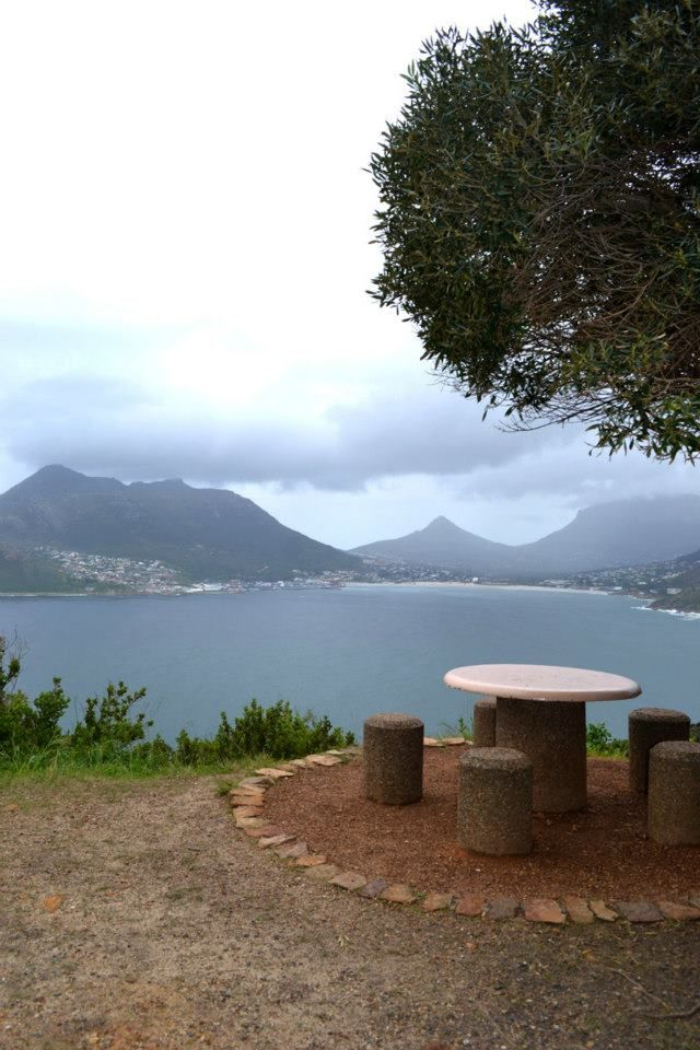 Travelling to South Africa with Via Volunteers opens the door to amazing views. Perfect picnic spot at Chapmans Peak, Cape Town.