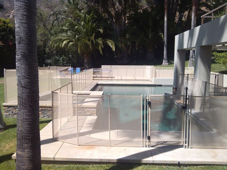 White swimming pool fence with self closing gate.