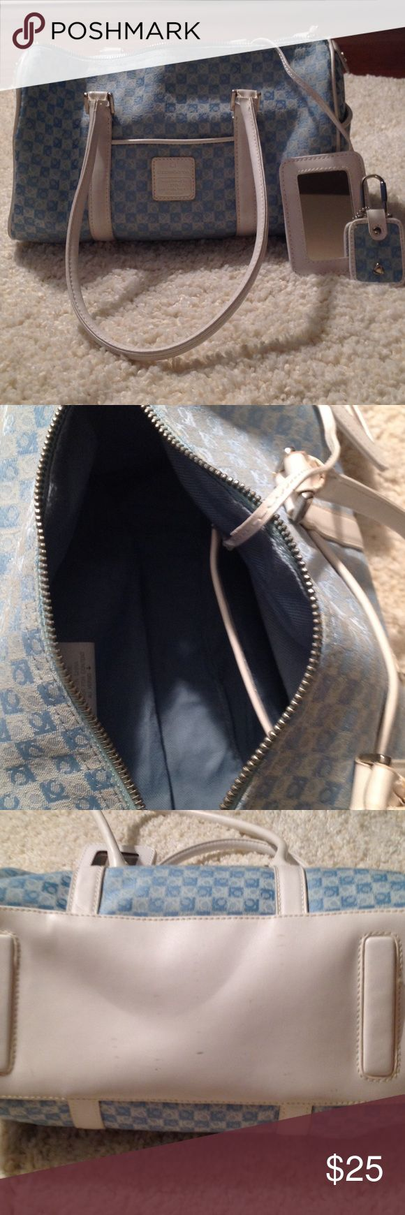 Liz Claiborne Handbag with accessories Attached mirror, key fob, exterior pocket on each end, small pocket on front of bag, 11 inches long, 6 1/2 inches high, 5 1/2 inches deep, no interior wear and tear, handles have some wear and bottom has wear. Refer to picture 3 AND 4 for wear. Zipper compartment inside. Liz Claiborne Bags Shoulder Bags