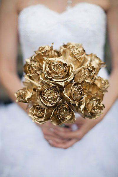 Give your bridal bouquet the Midas touch! Spray-painted roses pop against a white dress and add a regal feel to any wedding.