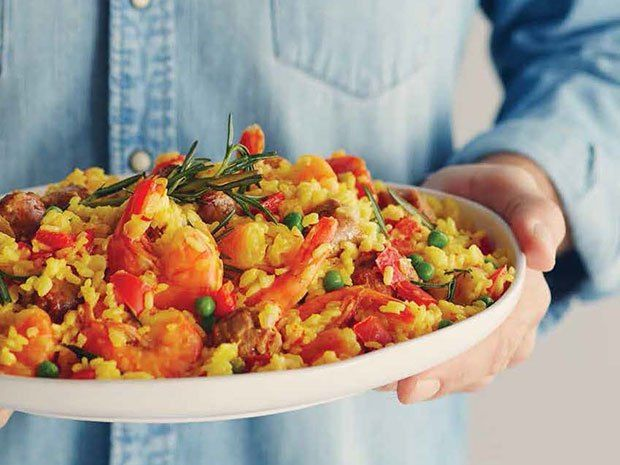 Rice and vegetables added to shrimp and sausages make this dish a meal-in-one.