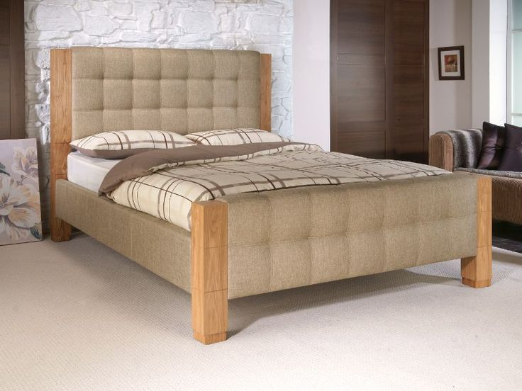 The Saturn is a contemporary fabric bed frame with chunky oak veneered bed posts.   The bedstead has a deep cushioned headboard and footboard in oatmeal coloured fabric, with chunky oak veneered bed posts for a contrasting finish.