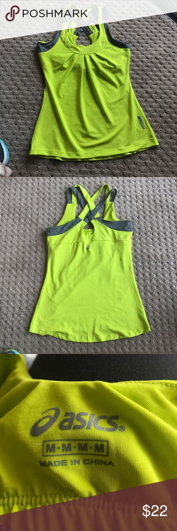 Workout tank built in bra. Stunning lime green workout tank top with built in light support bra. Crisscross straps in back. Grey trim. Pleated bodice. Worn once. Reflective insignia. Asics Tops Tank Tops