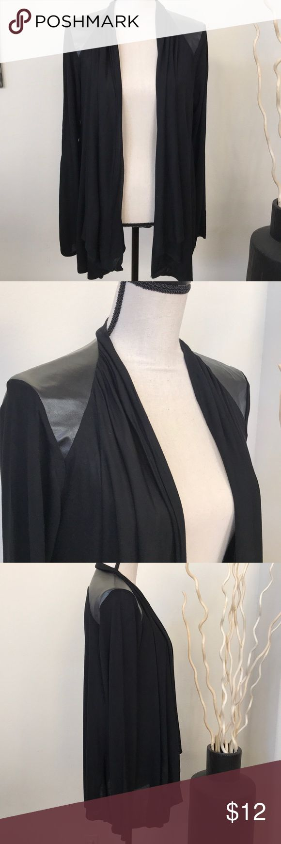 Black cardigan with faux leather detail on sleeve This cardigan is super light and is great to jazz up finish up an outfit. The upper shoulder has a pleated layering effect and gives a great detail to this simple cardigan. Cable & Gauge Sweaters Cardigans