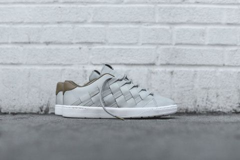 Sport the Nike Tennis Classic Ultra Leather shoes for a