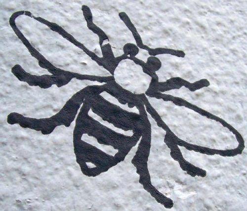 Black & white Manchester Bee graffiti on wall