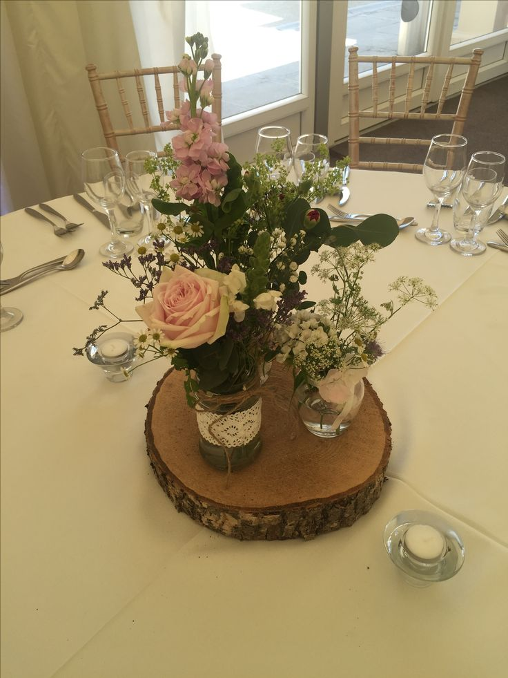 Jam Jar Arrangement: Anne's Lace, Sweet Avalanche, Mini Daisies, Limonium, Eucalyptus, Accimila Molus on a log base