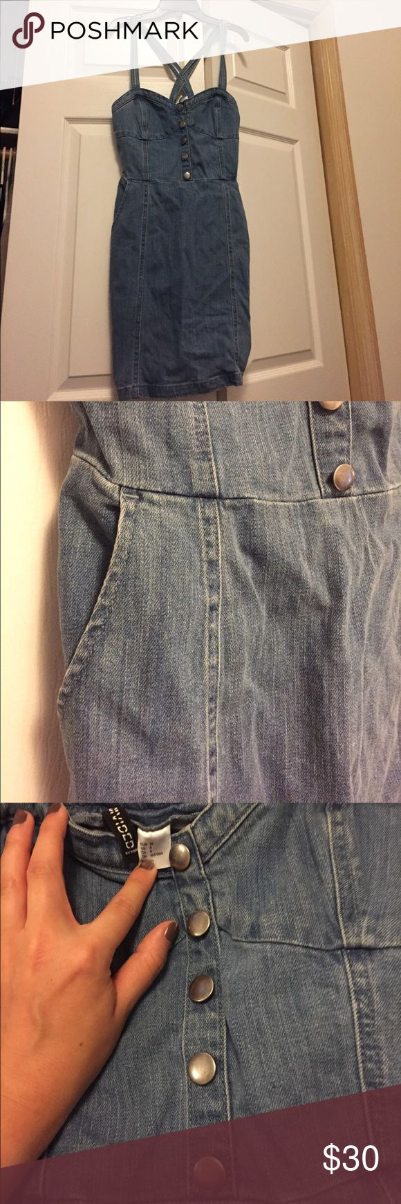 Denim mini dress Cute structured fit! By divided for h&m. Great condition. Zippered side. Straps cross in back & 2 pockets make this cute dress quite incredible! Smoke free home Divided Dresses