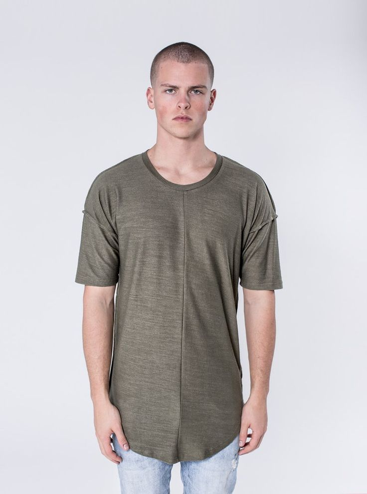 Alber - Deep Olive  $65.00    This lightweight textured t-shirt is a tasteful addition to any outfit. The Alber has a scooped bottom hem and dropped shoulders. The shirt is packed with subtle details such as the inside-out raw edged seams and cut and sew detailing. This fabric is a custom knit, which has been created with comfortability in mind.     https://kollarclothing.com/collections/all/products/alber-drop-shoulder-tee-deep-olive