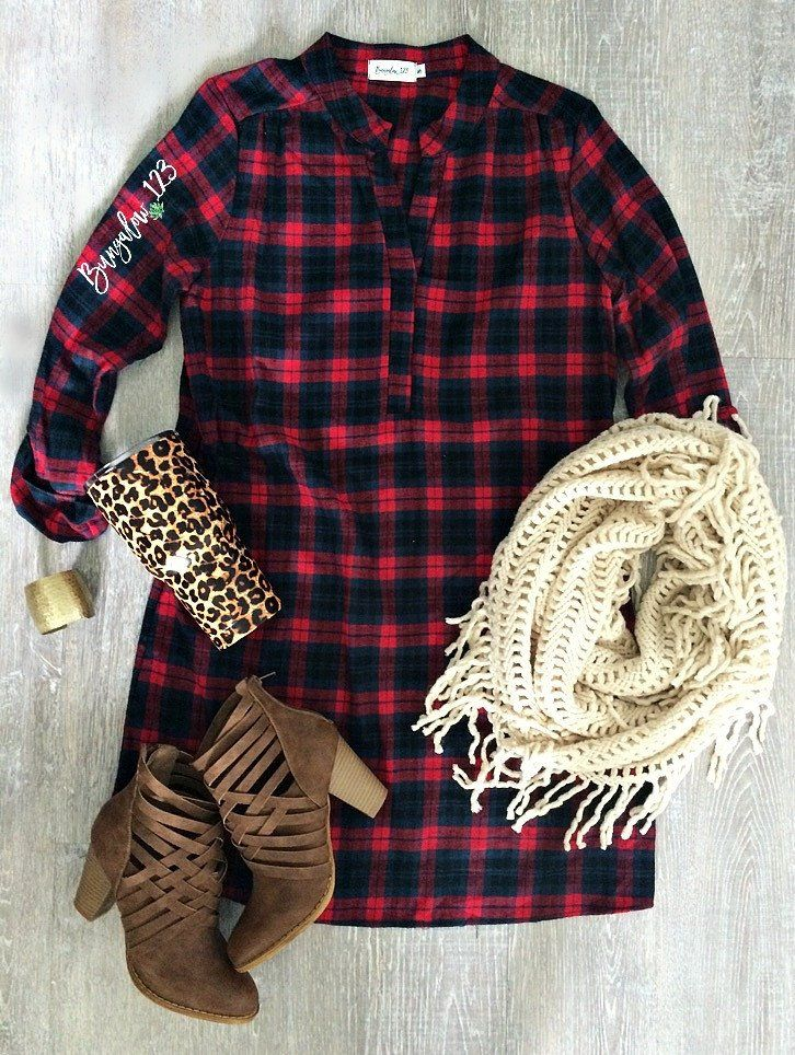 Versatile Tunic in Red, Black and Navy plaid. 3/4 roll-up sleeves. Mandarin collar with V-neckline. Soft cotton flannel material. Pullover style. This may be worn as a dress or as a top, depending on