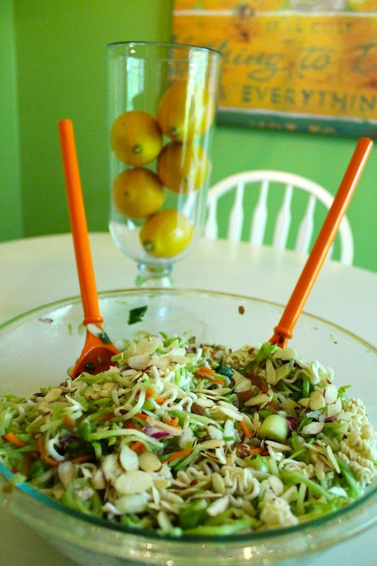 Broccoli Slaw & Ramen Noodle salad:1 (16 ounce) package broccoli coleslaw mix • 2 (3 ounce) packages chicken flavored ramen noodles • 1 bunch green onions, chopped • 1 cup sliced almonds • 1 cup sunflower seeds  • 1/2 cup white sugar • 1/4 cup vegetable oil • 1/3 cup cider vinegar  Mix and refrigerate overnight before serving.