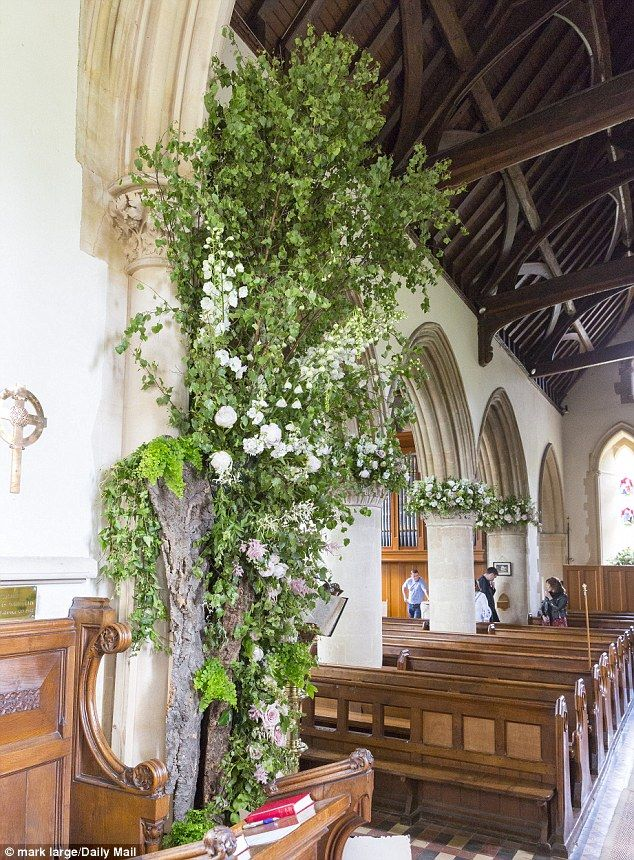 Secret garden: Bark, branches and leaves brought a slightly wild feel to the floral displays
