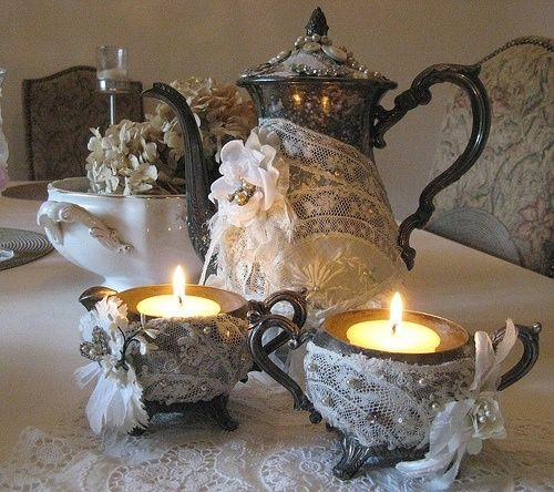 Love how this vintage silver tea set is wrapped in lace and secured w/pretty brooches.....beautiful idea!