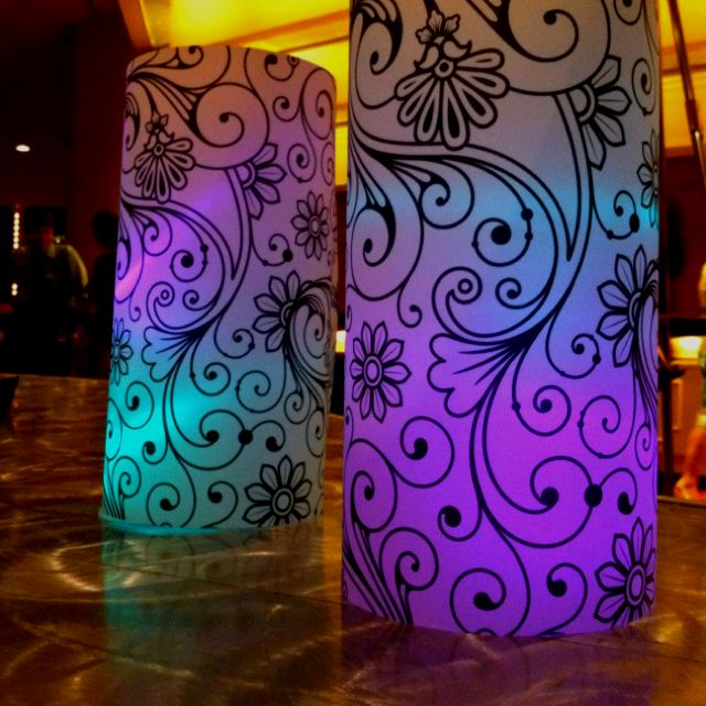 Simple wedding decor: heavy vellum 11 x 17 printed with scrolls. Inside are simple LED lights. One color place on ground then clear solo cup a second put on top for dual color. Cost: $1.12 each.
