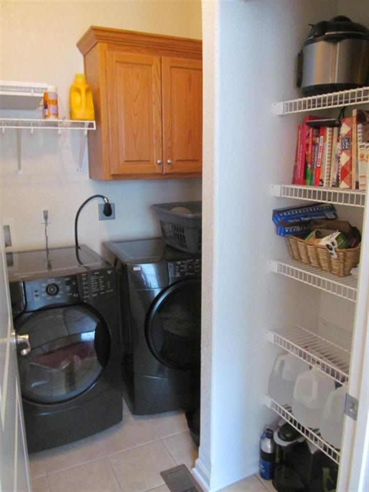 Spacious open floor plan with hardwoods in the kitchen, eating area and dining room. Wall of windows across the back living room into the sunroom. Additional 1/2 car garage space for storage. Basement finished in 2010 by Wedman Construction. Lot is one of the biggest in the neighborhood less than one block from the city limits and countryside. Seller offering $3,000 fence allowance. AHS home warranty included. #lawrence #kansas #lawrenceks #homeinlawrence #houseinlawrence #larrynorthrop…