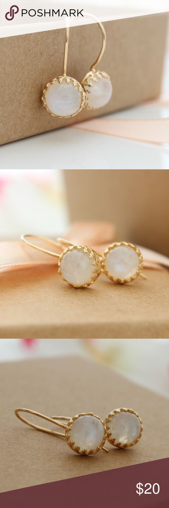Moonstone Earrings Delicate moonstone earrings features color changing moonstone gemstones set in delicate gold earrings.  Gemstone size: 8mm. Earrings length: 23mm, 0.8 inch. Ear hooks: 14K gold filled. Settings: High quality 14K gold plated brass. DYOSARA Jewelry Earrings