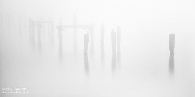An abstract image of Swanage Old Pier remains in a very thick sea fog