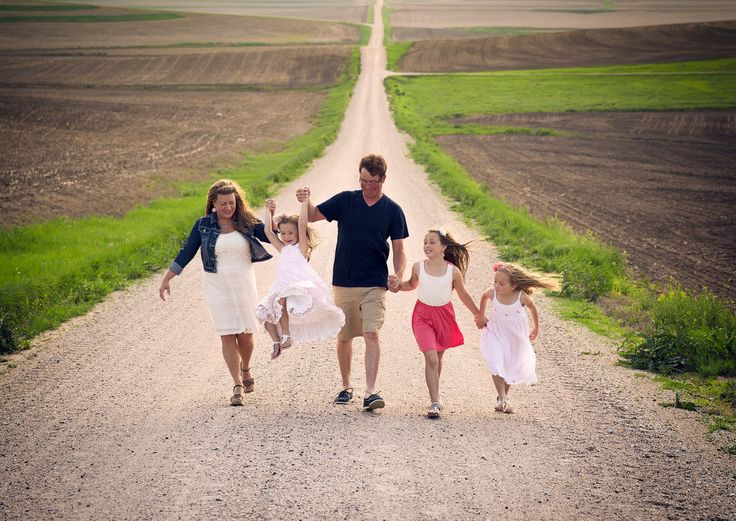 find a deserted back road to capture a family portrait...everyone could be holding hands as they are walking down the road together