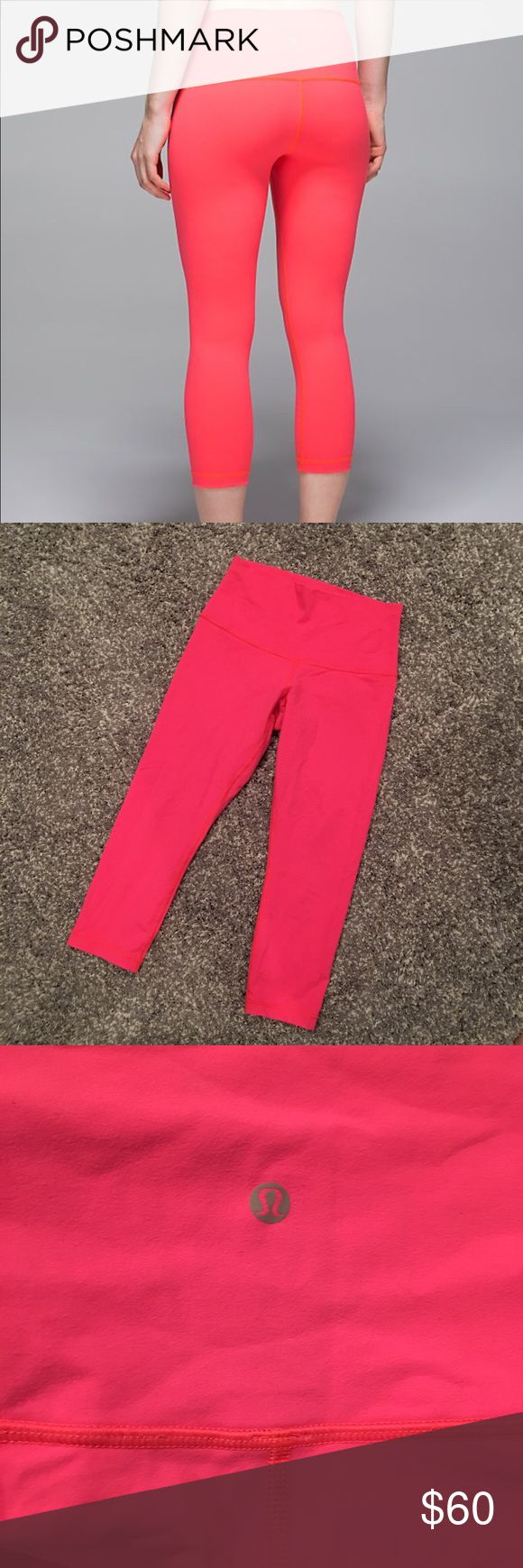 Lululemon Wunder Under Crop size 8 electric coral Lululemon Wunder Under Crop in electric coral. Size tag removed but these are an 8. Only worn a couple times. There is a loose hem (very slight) see pic. Any lululemon store will fix that for free! Otherwise great condition!! High rise but can be worn folded down.  Offers welcome. Bundle and save. lululemon athletica Pants Leggings